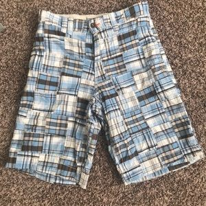 Men's longer length plaid shorts.